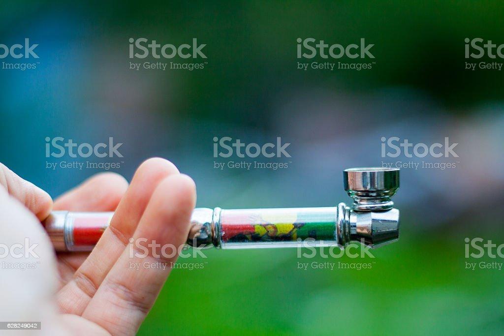 marijuana smoking pipe stock photo