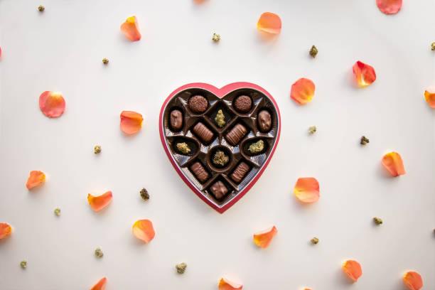 Marijuana Valentine's Day Chocolate Box with Cannabis Buds stock photo