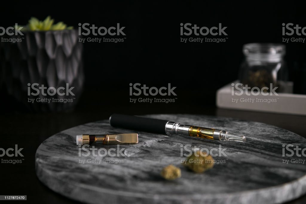 Marijuana Vape Pen, Concentrate and Buds on Dark Background Luxury Cannabis stock photo