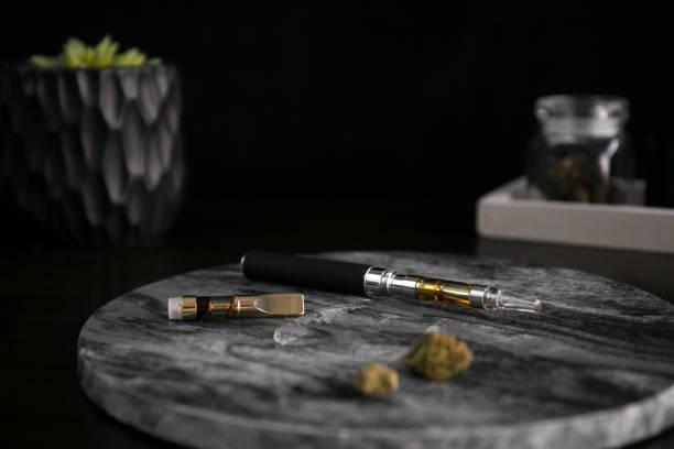 Marijuana Vape Pen, Concentrate and Buds on Dark Background Luxury Cannabis stock photo