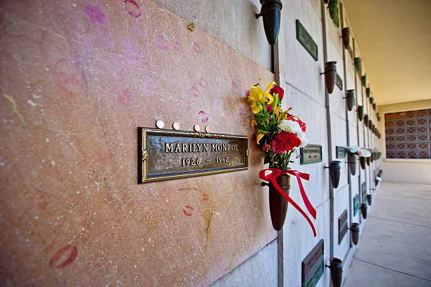 Marilyn Monroe Grave,  Los Angeles Los Angeles, USA  - May 15, 2013: Marilyn Monroe Grave with flowers and traces of kisses made by her fans, Westwood Village Memorial Park,  Los Angeles westwood neighborhood los angeles stock pictures, royalty-free photos & images