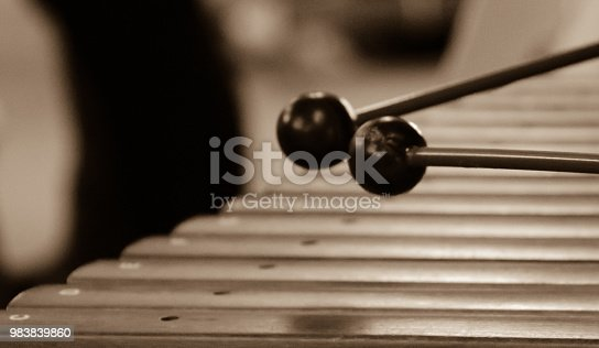 Close up of beaters playing a marimba
