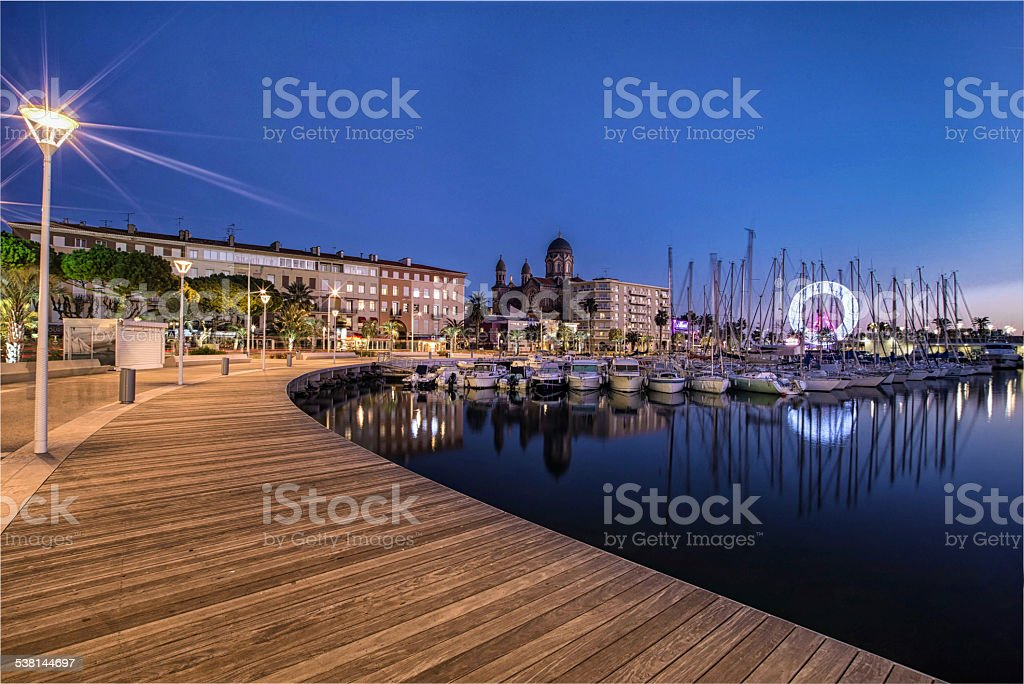 Marina and Ferris wheel on French riviera by night. stock photo