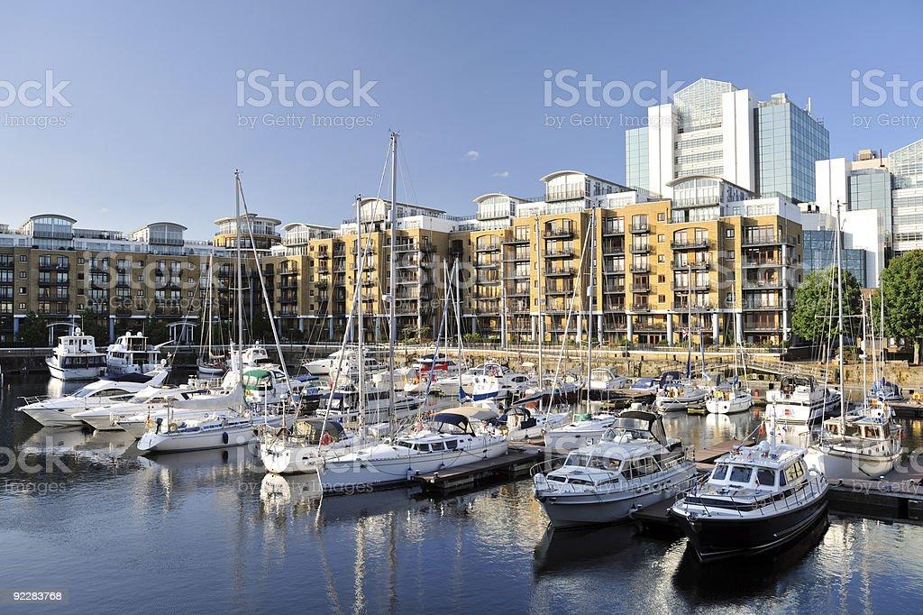 Marina and luxury flats, St Katharine Dock, London, England, UK stock photo