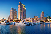 Marina and waterfront in downtown San Diego California USA illuminated at twilight blue hour.