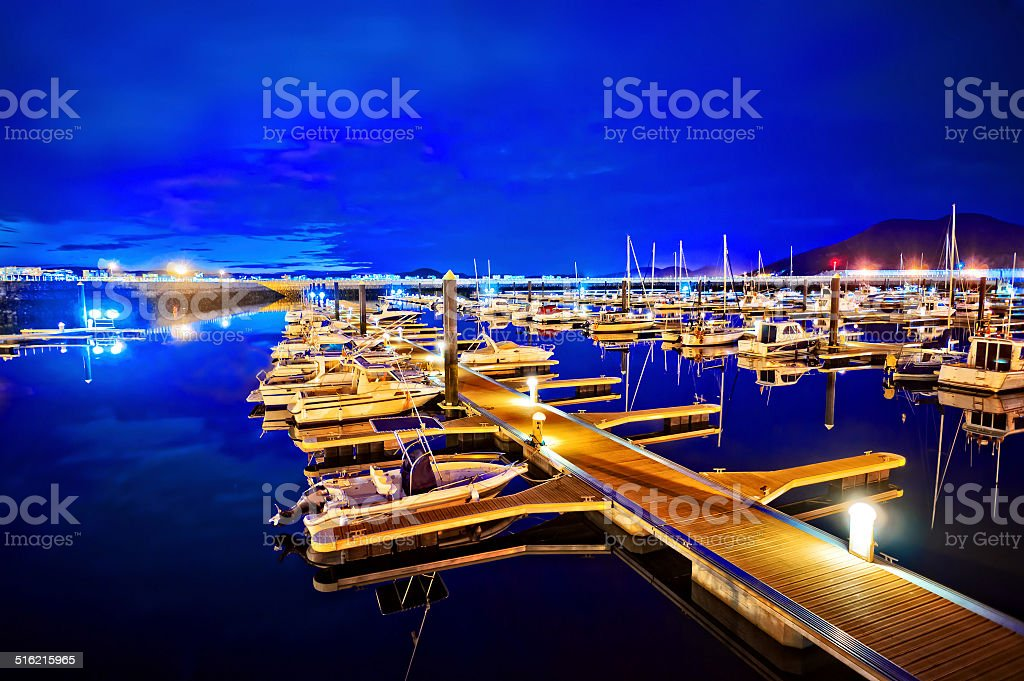 marina at night with moored yachts stock photo