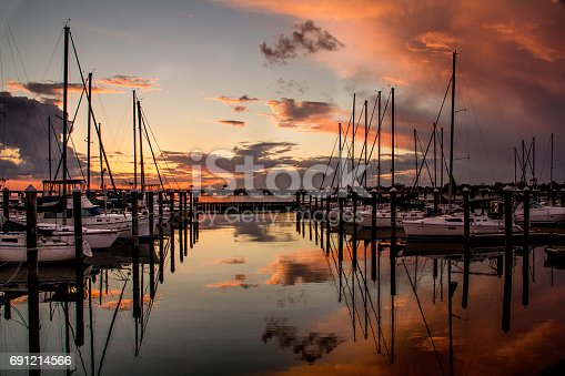 A marina full of boats greets the evening.