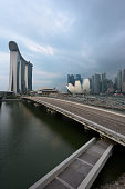 Singapore - 30 Aug 2019: Marina Bay seen from the highway crossover, with Marina Bay Sands Resort, the ArtScience Museum and the Central Business District in Singapore, Southeast Asia
