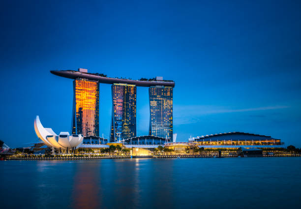 marina bay sands at dusk - singapore stock photos and pictures