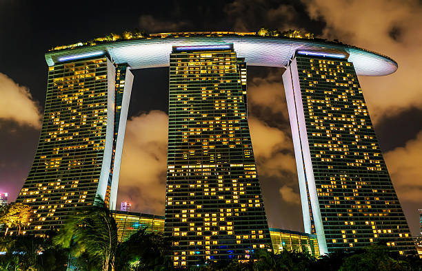 Marina Bay Sands Hotel and Casino at Downtown Core Singapore, Singapore - February 29, 2016: Marina Bay Sands Hotel and Casino at Downtown Core at night. Cityscape of luxury resort with swimming pool illuminated with light. esplanade theater stock pictures, royalty-free photos & images