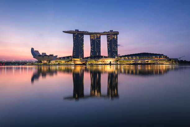 marina bay sands hotel during blue hour, singapore - marina bay sands stock photos and pictures
