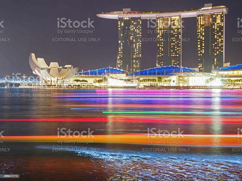 Marina Bay Sands Hotel in Singapore with Colorful Boats stock photo