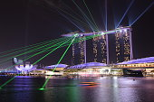 Singapore City, Singapore - March 30, 2016: Marina Bay Sands Hotel and Art Science Museum with the laser performance in Singapore at night.