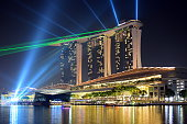 Singapore City, Singapore - April 30, 2016: Marina Bay Sands Hotel with the laser performance in Singapore at night.