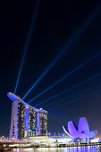 Singapore, Singapore - February 7, 2012: Laser show at Marina Bay Sands. Artscience museum to the right.