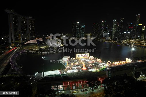 Singapore, Singapore - February 18, 2015: Marine bay with the Skyline of Singapore and the famous Marina Bay Sands hotel at night