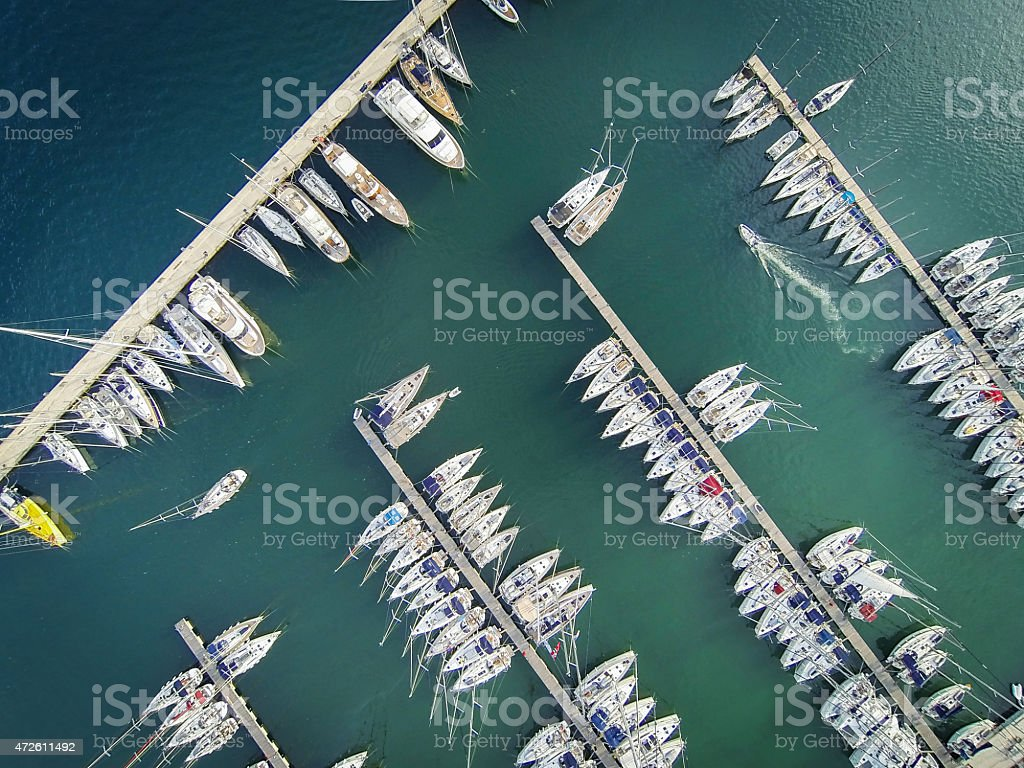 Marina bay with sailboats and yachts stock photo