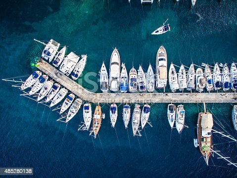 Aerial view on marina bay with sailboats and yachts.  http://santoriniphoto.com/Template-Sailing.jpg