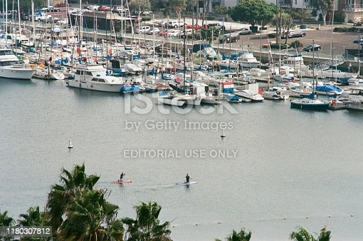 Los Angeles, California, United States - October 24, 2018:  Aerial view, large number of boats are visible moored in Marina Del Rey, Los Angeles, California, with people using standup paddleboards in foreground, October 24, 2018. (Photo by Smith Collection/Gado/Getty Images)