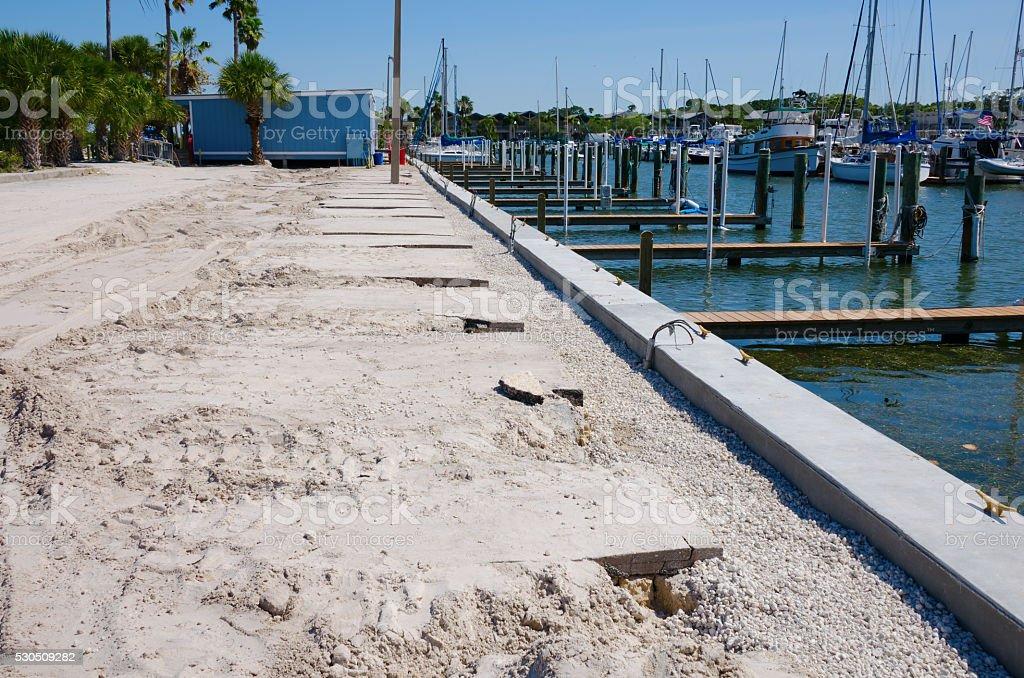 Marina dock breakwall and parking lot construction stock photo