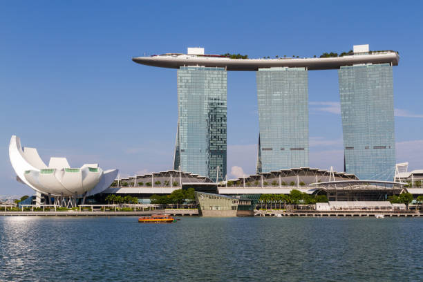 marina sands bay resort and blue skies - marina bay sands stock photos and pictures