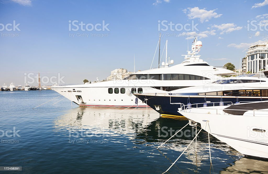Marina with big yachts in the summer season royalty-free stock photo