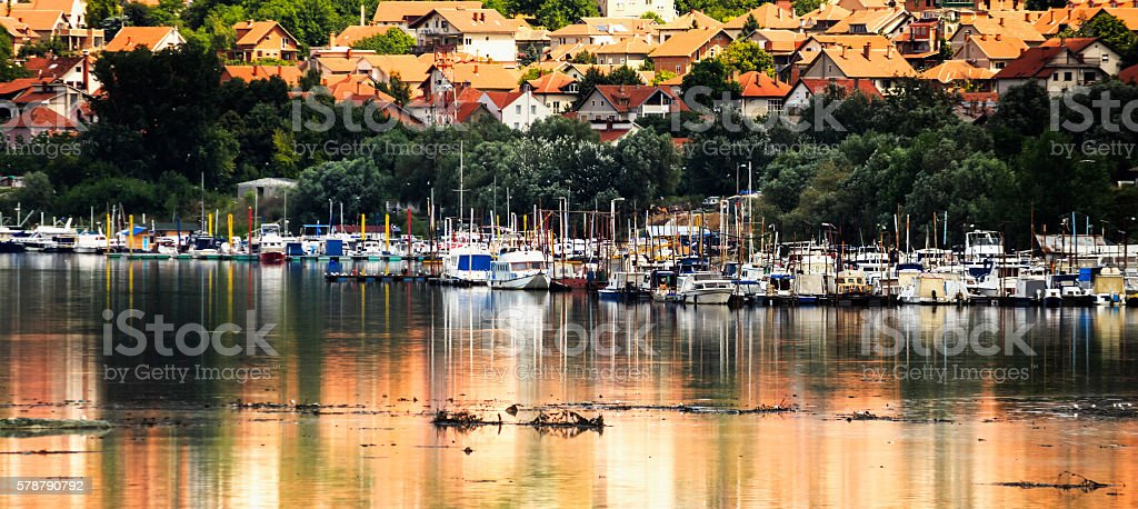 Marina with colorful boats that reflects out of water stock photo