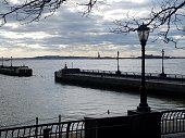 View from North Cove Marina to Hudson River and New York Harbor, with distant Statue of Liberty.  In lower Manhattan, New York City.