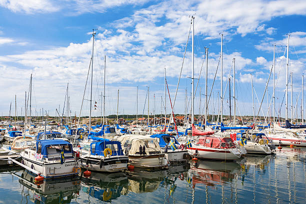marina with pleasure boats on the coast - bohuslän nature bildbanksfoton och bilder