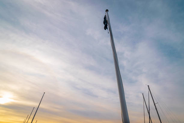 Marina_waterside_flag_morning_clouds_low_angle stock photo
