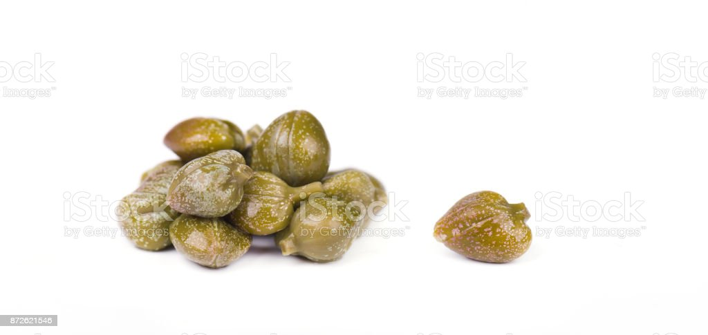 Marinated capers isolated on white background. Canned capers. Macro stock photo