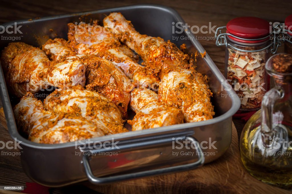 Marinated chicken drumsticks ready for baking. royalty-free stock photo