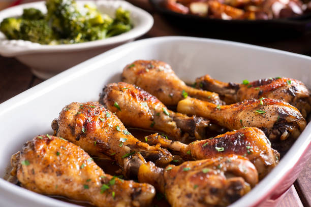 Marinated Chicken Legs Marinated Chicken Legs in a Baking Dish with Steamed Broccoli and Roasted Potatoes drumstick stock pictures, royalty-free photos & images