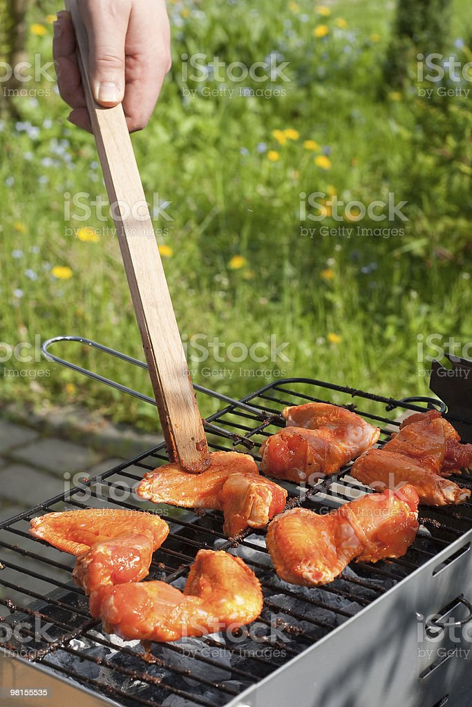 Marinated chiken on barbecue royalty-free stock photo
