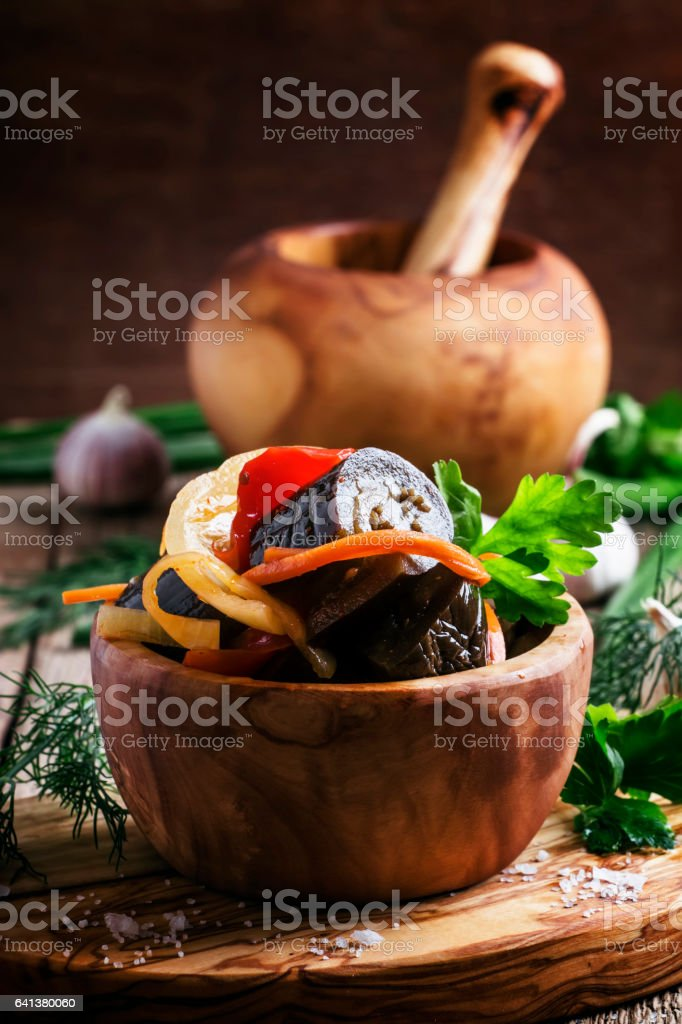 Marinated eggplant with onions and peppers in bow stock photo