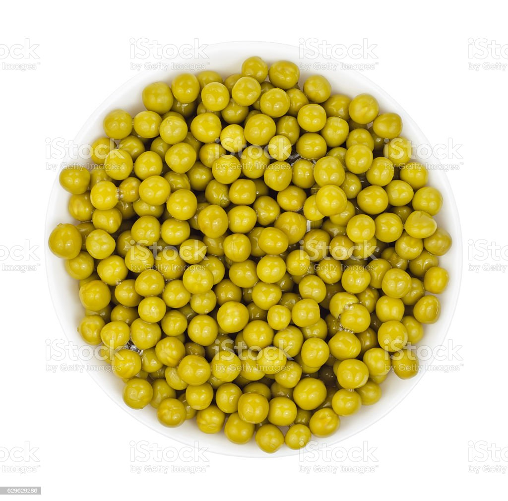 Marinated green peas in bowl top view isolated stock photo
