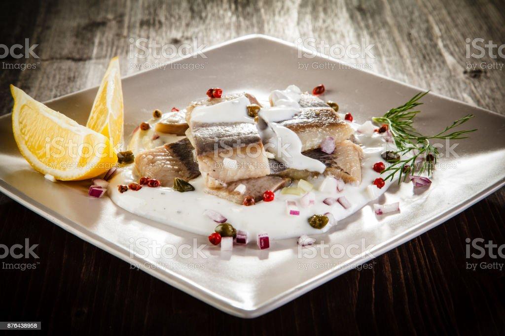 Marinated herring fillets in cream stock photo