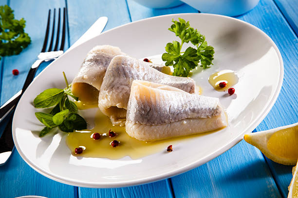 marinated herring fillets - herring stock photos and pictures
