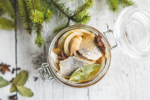marinated herring - herring stock photos and pictures