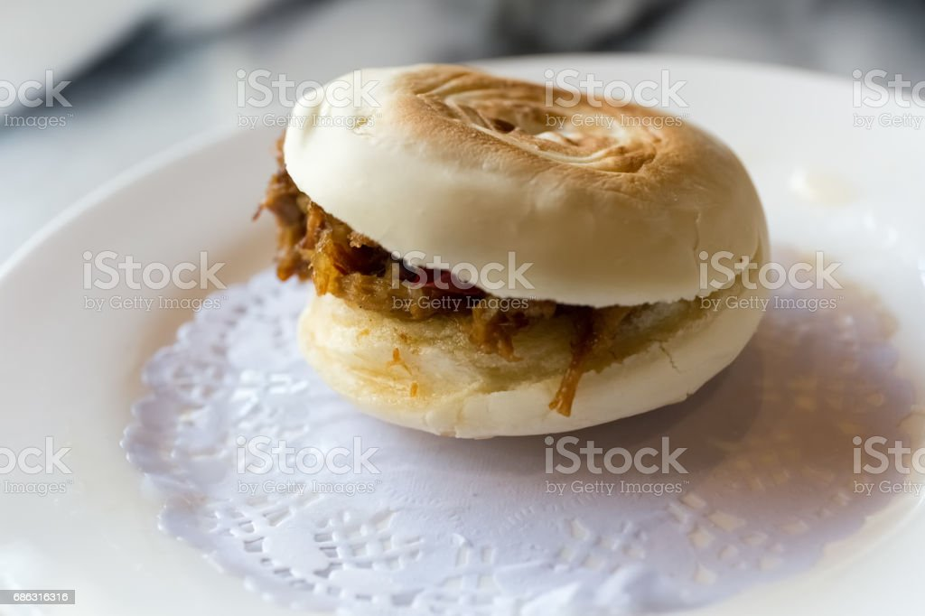 marinated meat in baked bun stock photo