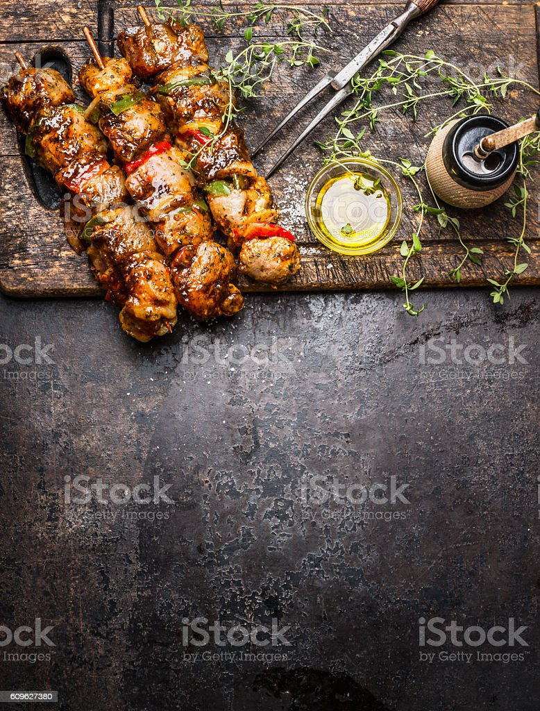 Marinated meat skewers with vegetables, seasoning and oil stock photo