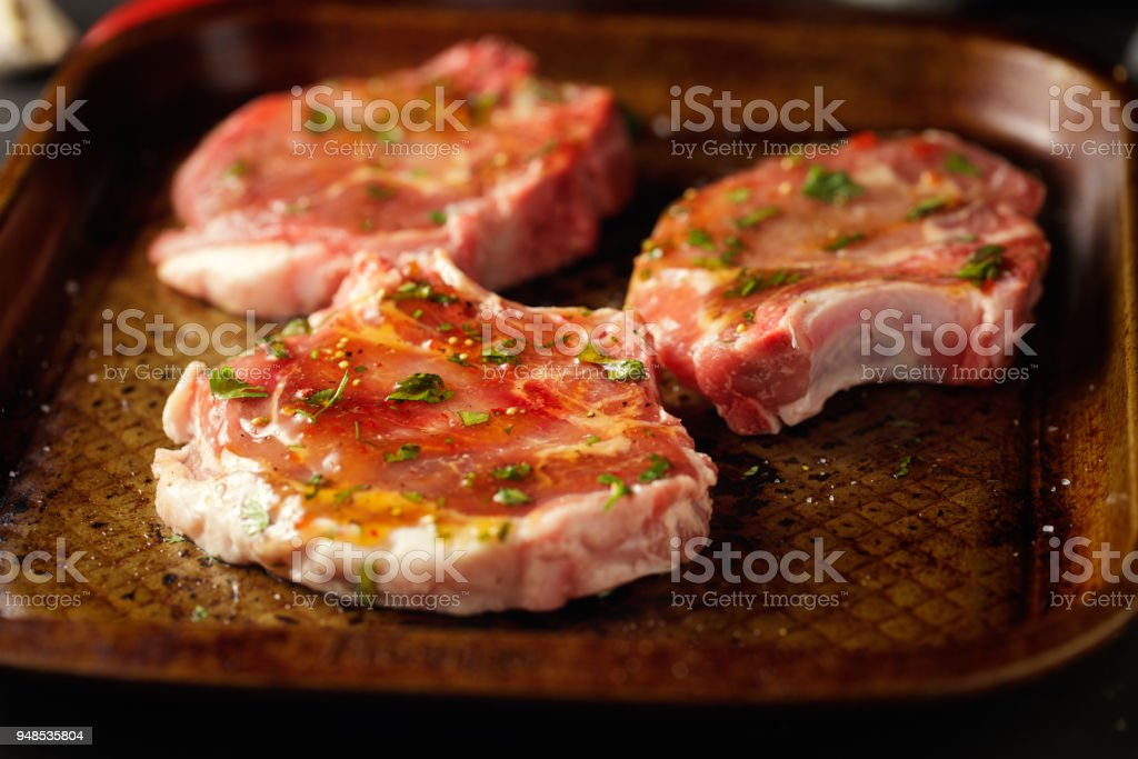 marinated pork chop stock photo