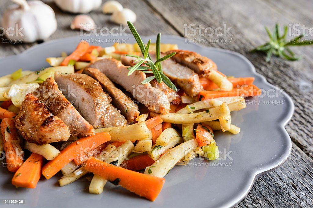 Marinated pork neck with vegetable stock photo