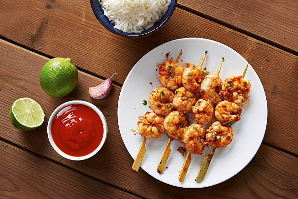 Marinated prank skewers with rice Sri racha marinated prank skewers with rice sriracha tiger zoo stock pictures, royalty-free photos & images