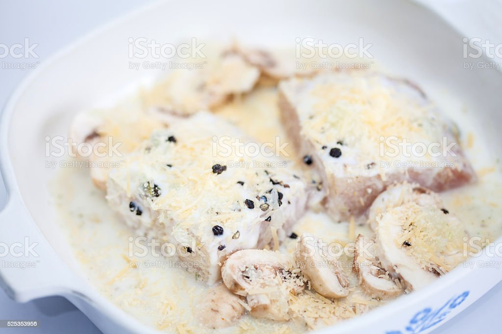 Marinated raw sea bass fillet with mushrooms stock photo