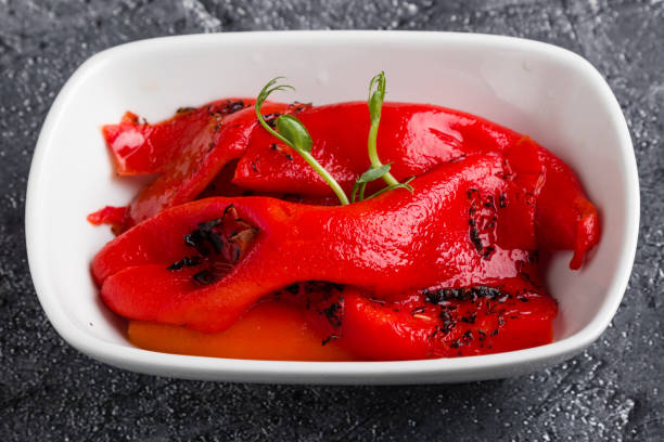 marinated roasted pepper vegetable in white bowl stock photo