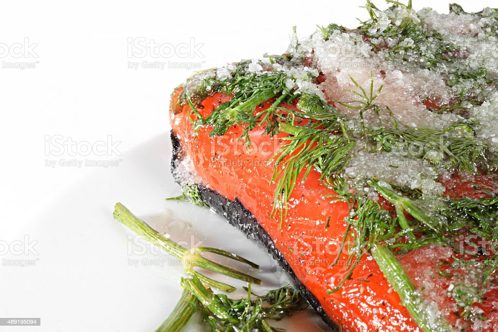 Marinated salmon with dill and black pepper stock photo