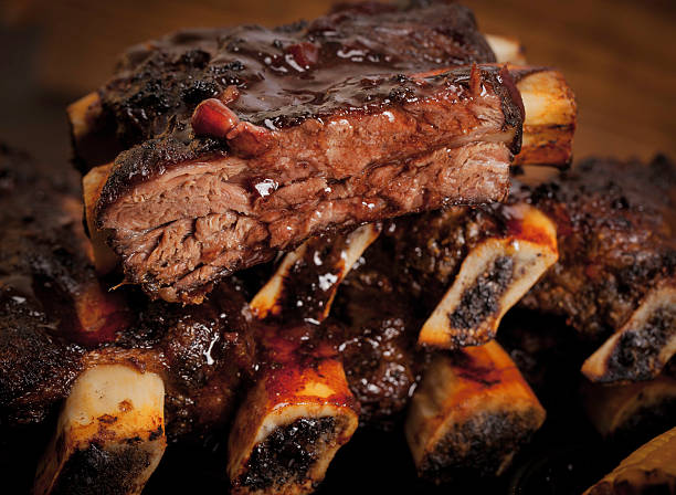 marinated stack of beef short ribs - ribs stock photos and pictures