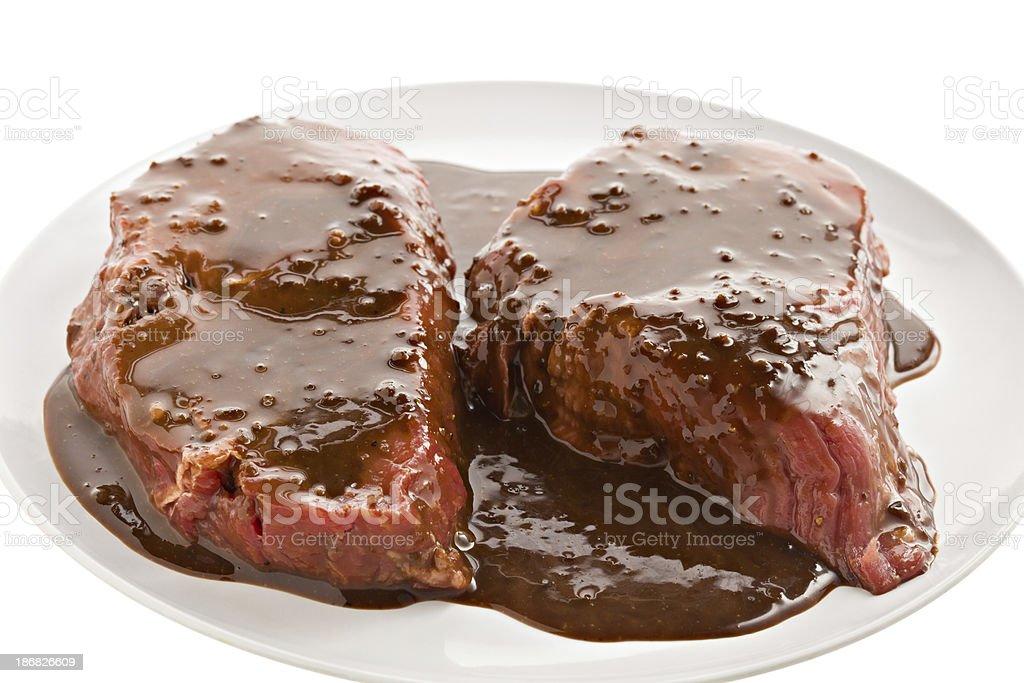 Marinated Steaks stock photo