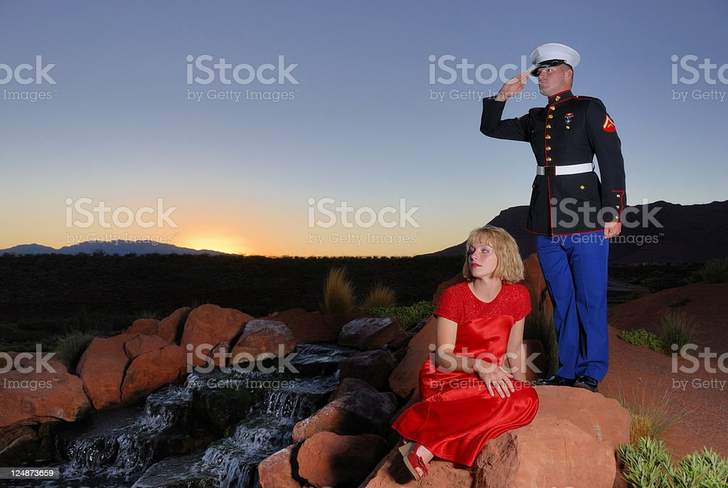Marine and His Girl Looking Into the Future royalty-free stock photo